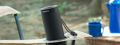 SRS-XB23 outdoors in collapsible chair cup-holder.