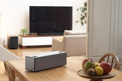 Wireless speaker is on a room.