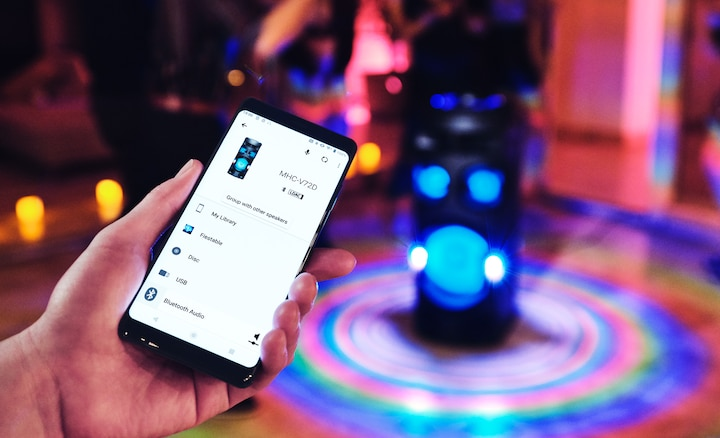 Partygoer using the Sony | Music Center app on their smartphone
